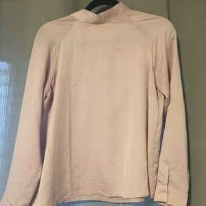 High neck blouse in blush.